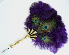 purple peacock fan Centerpiece www.tablescapesbydesign.com https://www.facebook.com/pages/Tablescapes-By-Design/129811416695