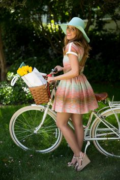 Gal Meets Glam spotted in a colorful cut out summer dress and the Banana Republic perforated Ashbury tote. Carrying tulips, naturally.