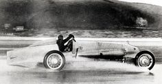 Sir Malcolm Campbell, pictured here in his Bluebird car, broke his own speed record in 192...