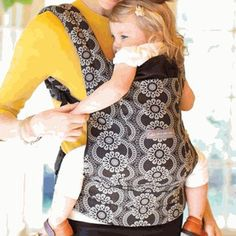 Ergo baby carriers are better for baby's hip and spine development because babies are not dangling by their crotch.  They are expensive, but SO worth it.  You can carry baby on your back, hip, or front.  They are one size and you can even use them for toddlers.  We LOVE ours.