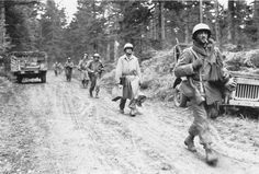 """Soldiers of the """"Lost Battalion,"""" US Seventh Army, France, late 1944. (US Army Center of Military History)"""