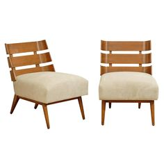 Remarkable Pair of Walnut Slat Back Lounge Chairs by Robsjohn-Gibbings | From a unique collection of antique and modern lounge chairs at https://www.1stdibs.com/furniture/seating/lounge-chairs/
