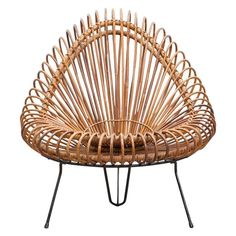 basketware lounge chair from 1955 is in excellent original condition, designed by Janine Abraham and Dirk Jan Rol. The elegant basket seat shell is held by black lacquered steel frame. Another example in stock. Manufactured by edition Rougier. $8500