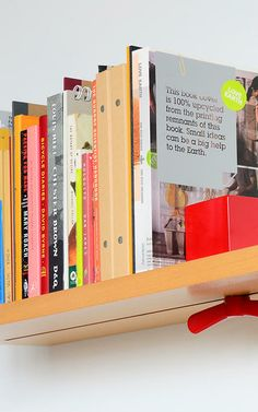 Wall-Mounted Shelf Prevents Toppling Books With Sliding Lock