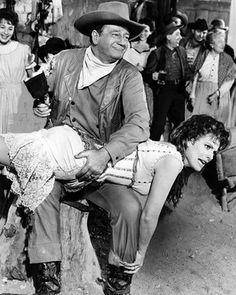 John Wayne and Maureen O'Hara in the movie McLintock. Just one of the absolute best movies John Wayne made. John Wayne Quotes, John Wayne Movies, Hollywood Stars, Classic Hollywood, Old Hollywood, Hollywood Icons, Old Movies, Great Movies, Iowa
