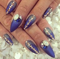 Blue and gold nails with bling bling