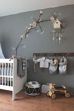 Classic clean white crib with rustic accessories -  adorable! Love the flowering branch and birdhouse...