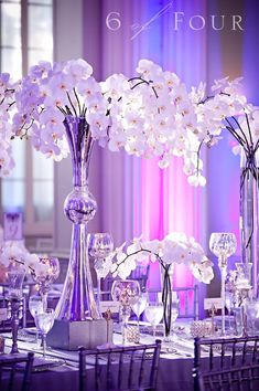 Gorgeous phalaenopsis orchid arrangements. Love the silver decor too.