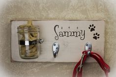 Can someone make me one of these!!! Cute dog stuff holder -treats next to the collar and leash - brilliant