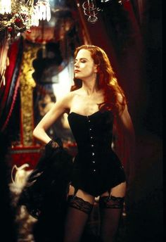 Nicole Kidman poses in a black corset costume as Satine in Moulin Rouge
