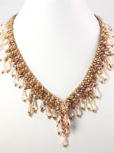 MadDesigns: Coppery Elegance. Beautiful Beadwork via Marcia Decoster.  To me, she is definitely the Queen of Bling.