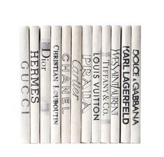 "Add instant chic to your bookshelves with a set of classic fashion decorative books. Set of 12 Parchment Bound Books approximately 8"" high Ships in 2-3 weeks"