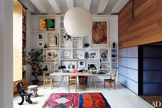 The shelves in this Manhattan apartment serve as a display space for works by Andy Warhol (top left) and Louise Bourgeois (top right), among others.