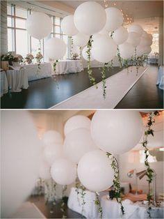 Vintage inspired wedding decoration details using balloons and leaf garlands