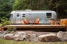 Each revamped Airstream has a propane-powered campfire to accompany of cabin-cool adirondack chairs, and a few even have hot tubs for two on the patio, too. Airstream Rental, Airstream Camping, Airstream Living, Airstream Remodel, Airstream Renovation, Airstream Trailers, Camping Glamping, Camping Trailers, Camping Gear