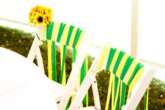 Bride and Groom chairs at the reception. Mine has the small sunflower bouquet attached to the chair. This was made by a friend's supremely talented mother as the bow on our bridal shower gift. I knew it would be perfect at our wedding! We also did our parent's chairs at the ceremony with the ribbon to set them apart from the guests.