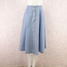 Vintage 60s Denim Twill Button Front Skirt. Light blue denim flared midi skirt with front button closure and back box pleat. Size: Small Waist: 25 inches Hips: Open Shoulder to Hem: 29 inches Material