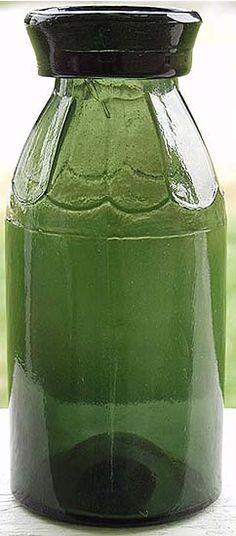 "Quart size ""Petal Jar"" in dark green with nice iron pontil and crude top."