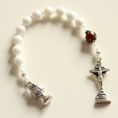 First Communion pocket rosary.