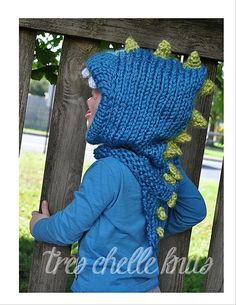 Details on this one are added using crochet. However, pattern includes options to knit details. Crochet Dinosaur Hat, Crochet Dragon, Knitted Hats, Crochet Hats, Crochet Animals, Crochet Ideas, Crochet Projects, Crochet Hooded Cowl, Ravelry