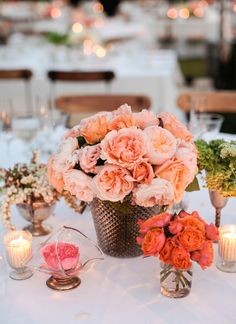 Clusters of perfectly peachy garden roses, hanging pieris japonica, and Queen Anne's lace were all arranged by The Velvet Garden for this outdoor celebration.