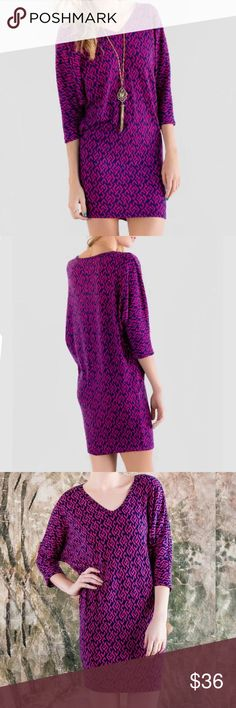 """Francesca's FONTANA Berry Dolman Sweater Dress M From Francesca's """"Alya"""" collection: Fontana sweater dress. Size medium. Raspberry pink / purple & navy blue geometric print. Can be worn as a dress or a tunic. 3/4 sleeves. V-neck. Approx 33"""" long down the back. Roomy bust, due to the relaxed dolman sleeves and easy silhouette. Very figure flattering! A soft & cozy blend of 96% poly & 4% spandex. Pre-owned. No flaws (holes, stains, stretched out areas), but can see that the sweater fabric is…"""