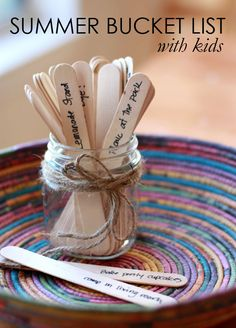 Love Summer Bucket List Ideas + Activities listed on popsicle sticks in a mason jar!