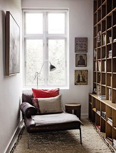 Bookshelves, cool lamp and well chosen pictures. 'Nuff said.