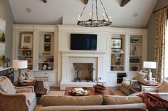 TV over fireplace with built ins on either side....