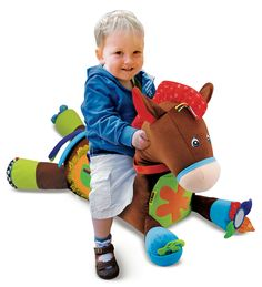 Giddy Up & Play invites babies to pat, pull, and even climb right on! This precious pony has rattles, teethers, crinkle fabric, and fringe to capture babies' attention, and plays trotting and neighing sounds when patted or ridden. It's huggably soft and packed with whimsical novelties to engage the senses and nurture growing skills.