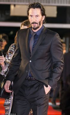 Her co-star: Keanu Reeves is seen here at an event in Tokyo in 2015...
