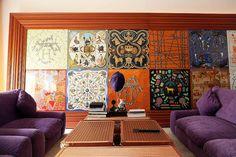 wall of framed scarves