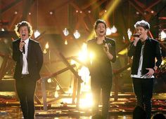 Harry, Louis and Niall performing!
