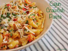 Cajun Crawfish Pasta Recipe featuring juicy crawfish, mushrooms, red bell pepper, tomatoes and Parmesan cheese.