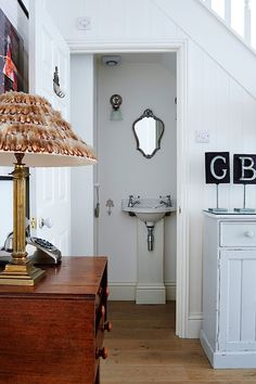 Under the stair powder room in Isabel and George Blunden London renovation | Remodelista
