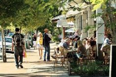 Noosa's Hasting's street is a great example of a bustling, tree-lined, stylish high traffic pedestrian area.