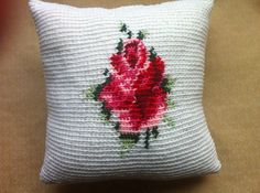 Red Rose Pillow by HannahsMetalIronwork on Etsy. Inspired by the classic cross stitch rose. $35.00 crochet