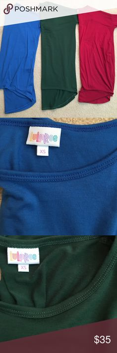 3 for 1 Lularoe Irmas! Blue, hunter green, dark red irmas three for the price of one. All 3 have been worn but are still in good condition! The green and red are perfect for the holidays! LuLaRoe Tops Tunics