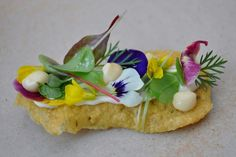 Chick pea wafer, cream cheese, herbs and flowers dish at L'enclume