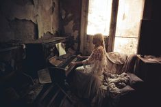 'The Lady Of Moat View' two.. The 6th installment in the Abandoned Fashion Series. I love this piano, so so beautiful! The whole place is beautiful but there was just something about the piano, it still had sheet music there from 15 years ago. I'm not sure I will ever come across something like this in the series again so I hope I did it justice! Photography: Luke Woodford Designer: Joanne Fleming Model: Tabby Richards Hair and make-Up: Rosie Lee