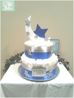 My new Moon & Stars Diaper Cake was created for a friend and includes approximately 55 diapers for a new infant.