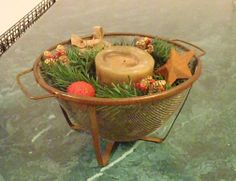 Rusty strainer, used candle and left over decorations.