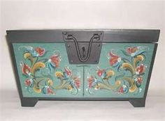 Rosemaling trunk...this looks similar in coloring and style to an item my grandmother had.