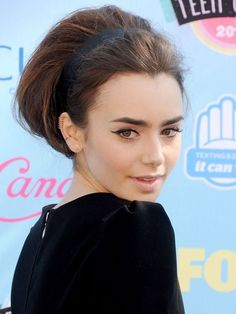Want to leave an impression? Take a cue from Lilly Collins' and rock a bouffant faux-bob with an Audrey Hepburn-esque headband. Glamour overload.