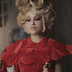 4 New Stills Of Effie Trinket - This is her best outfit - It's exactly how I imagined her in the book!