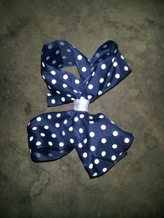 Small navy blue with white polka dot bow