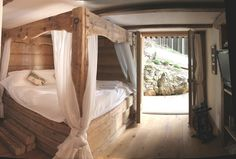 Rustic bed at Chalet LeMoulin in the French Alps