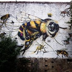 Part of street artist Louis Masai Michel's 'Save the Bees' mural project, to highlight colony collapse disorder (via Colossal)