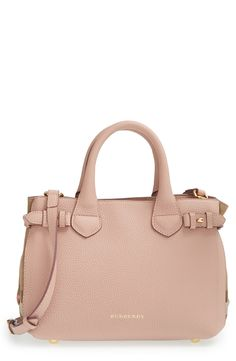 Carrying all the fashionable essentials in this chic nude-blush Burberry leather tote.