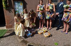 The bridesmaids and flower girls get ready to throe confetti at Jim and Jess' wedding